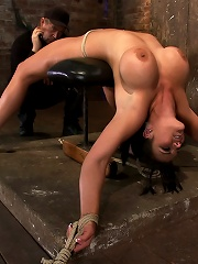 Cute girl with massive tits, bound & oiledPussy flogged, fingered, made to cum over & over.