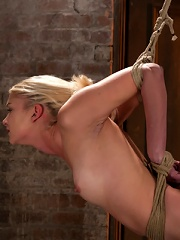 Sexy Blond with amazing hard fit body, suffers Category 5 SuspensionFirst hardcore bondage shoot